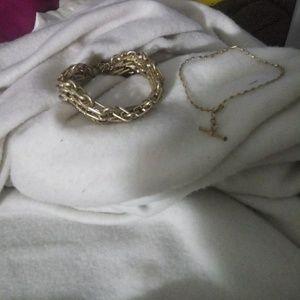 2 gold colored bracelets